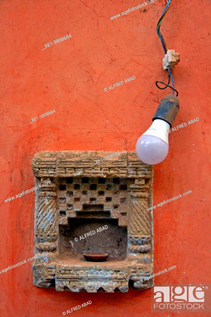 Stock Photo: light bulb on red wall, Blanes, Catalonia, Spain.