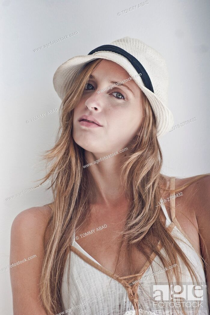 Stock Photo: blonde woman with a panama hat and white dress / white background.