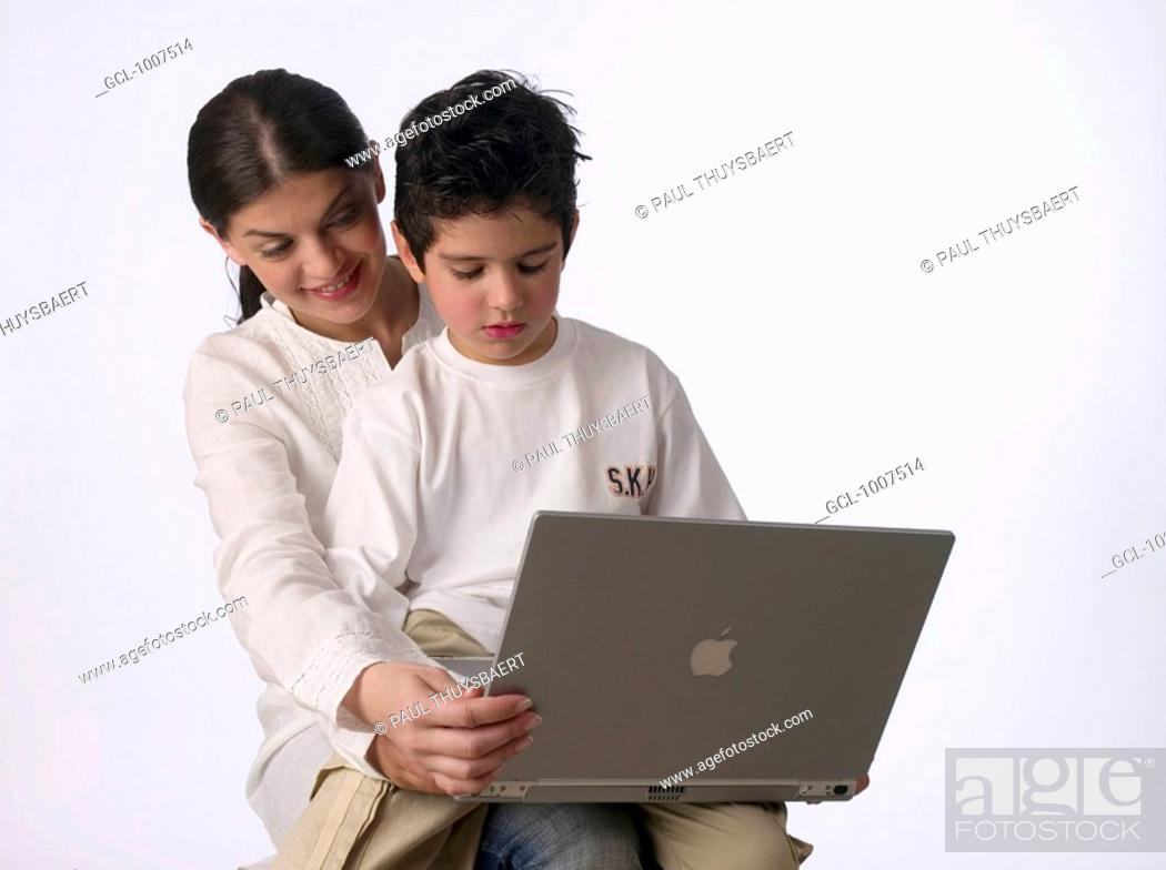 Stock Photo: Mother with son holding a laptop.