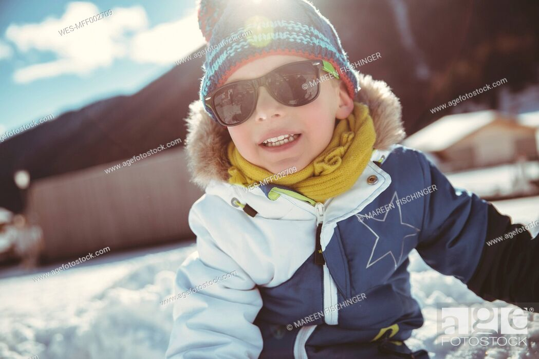Stock Photo: Italy, Val Venosta, Slingia, boy with sunglasses in snow.