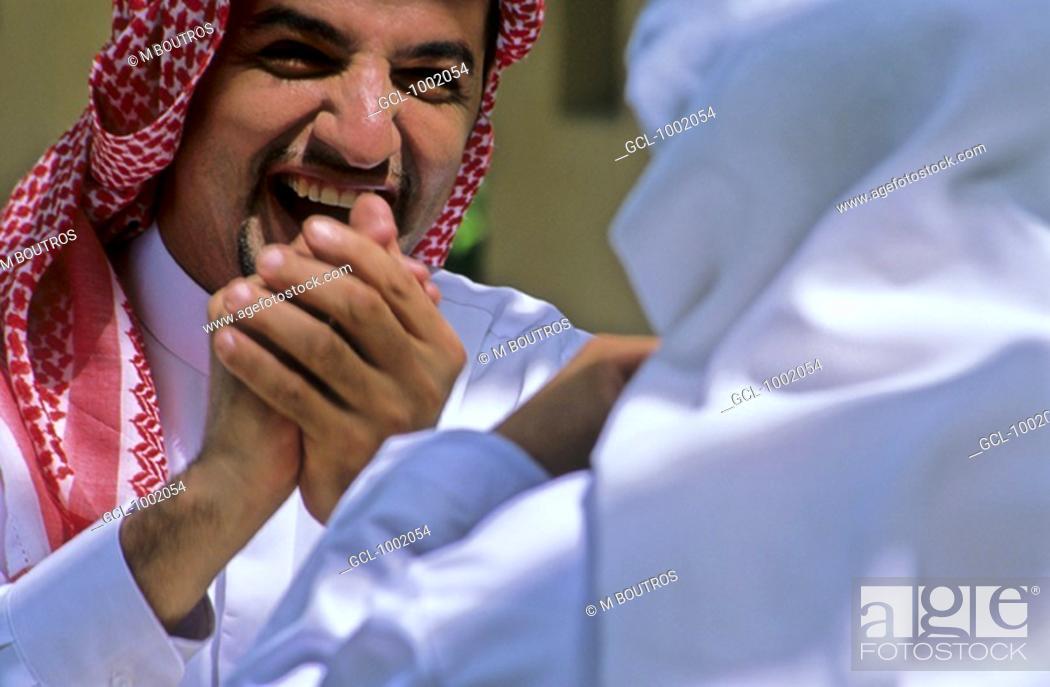Stock Photo: Arab men sharing a laugh.