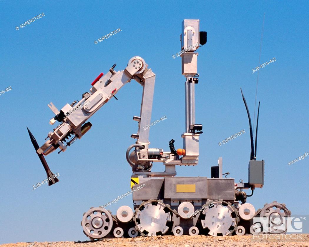 An Explosive Ordnance Disposal Robot Grips a Depleted