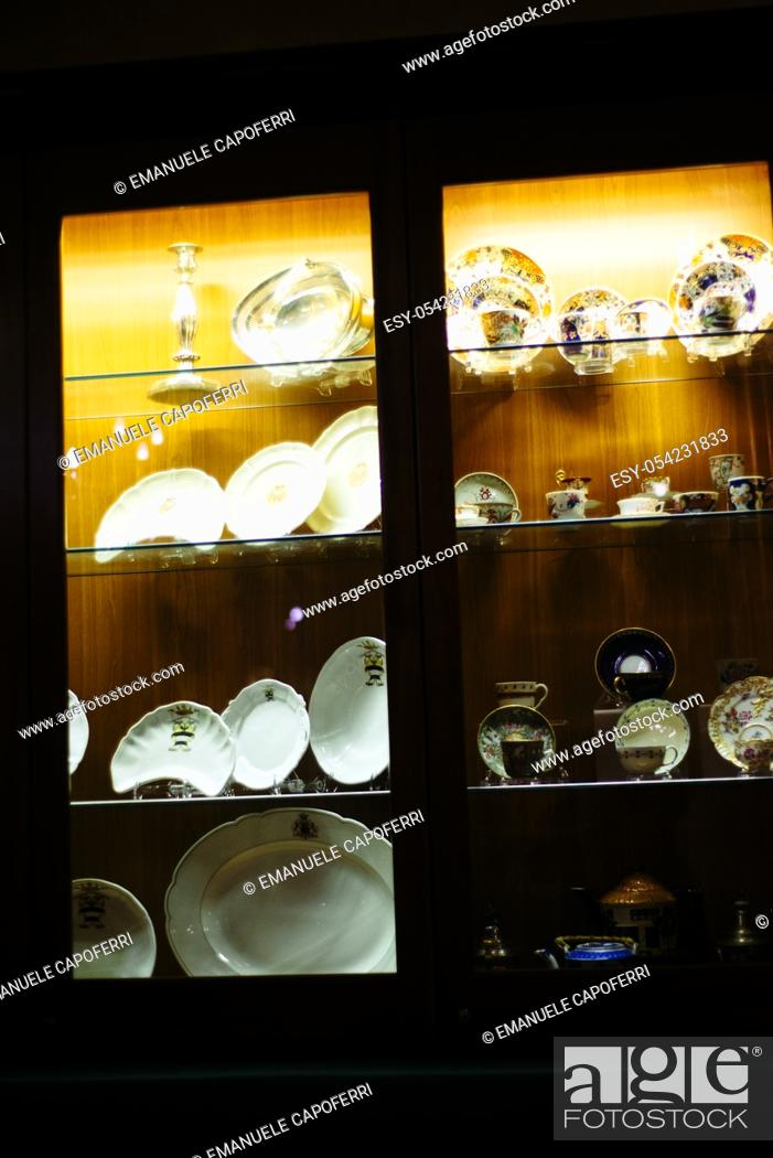 Stock Photo: Showcase with antique ceramic collection.