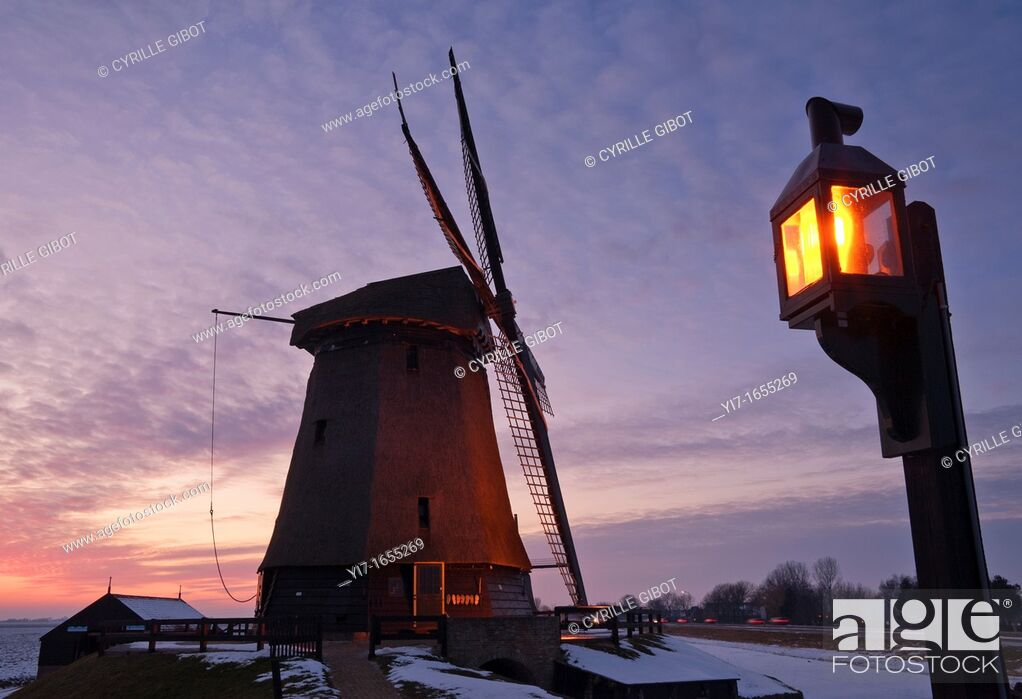 Stock Photo: Dutch Windmill at dusk, Schermerhorn, Noord Holland, Netherlands.