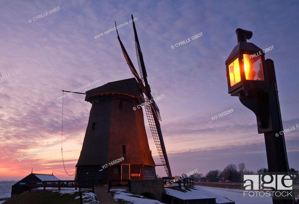 Stock Photo: Dutch Windmill at dusk, Schermerhorn, Noord Holland, Netherlands.