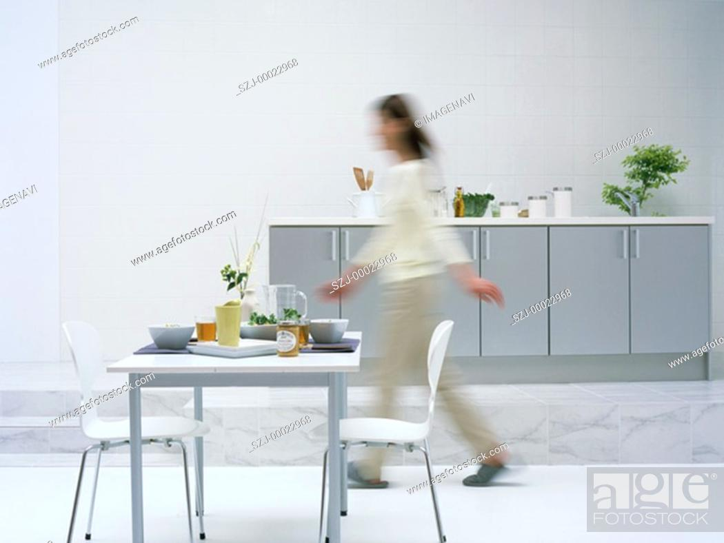 Stock Photo: Woman in dining room.