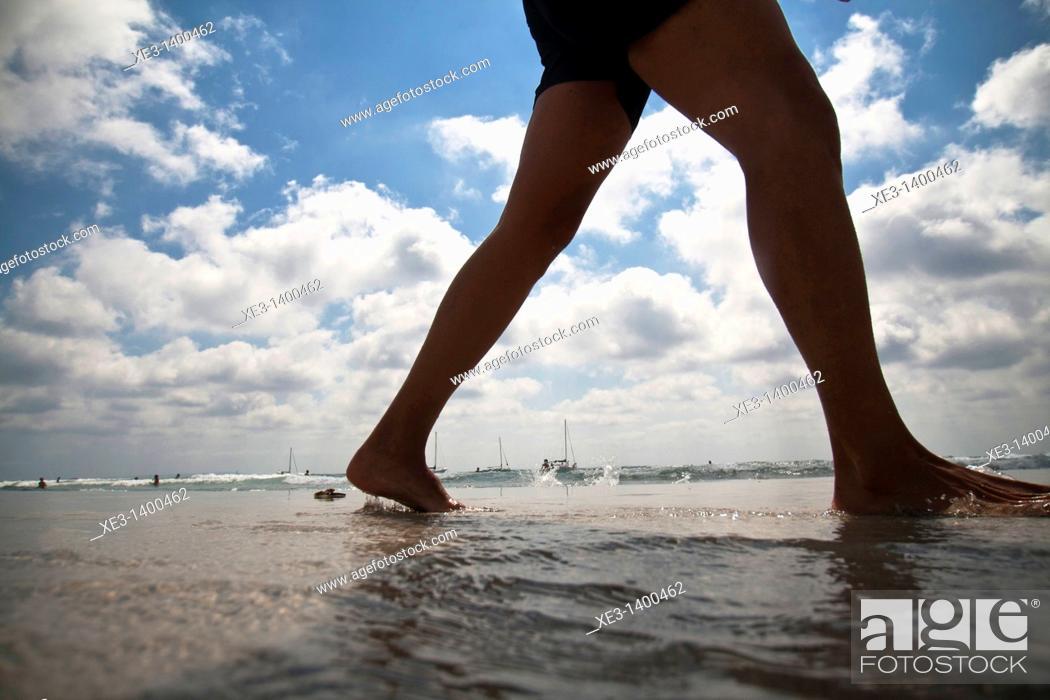 Stock Photo: Woman legs at the Beach, Ibiza, Spain.