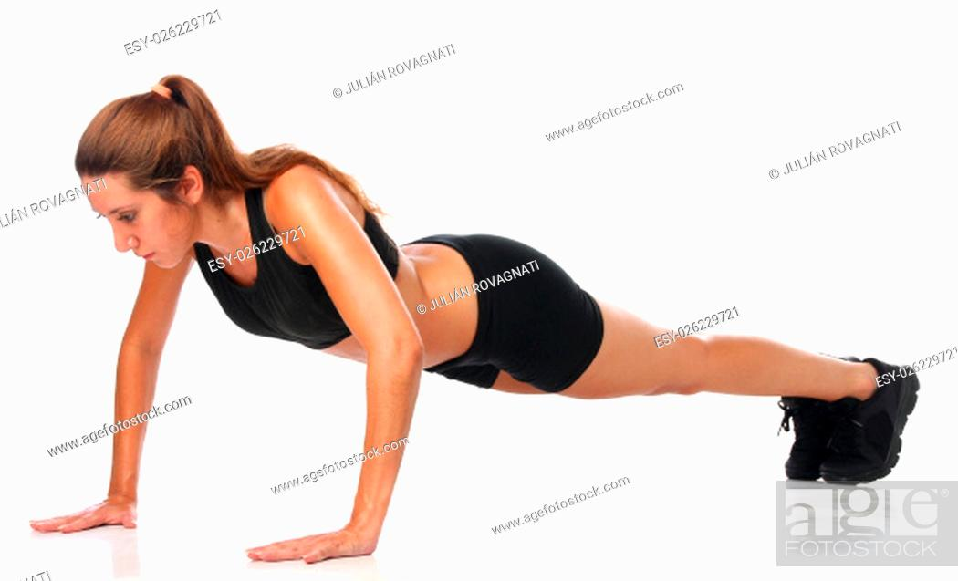 Stock Photo: Happy young woman holding doing exercise and stretching over white.