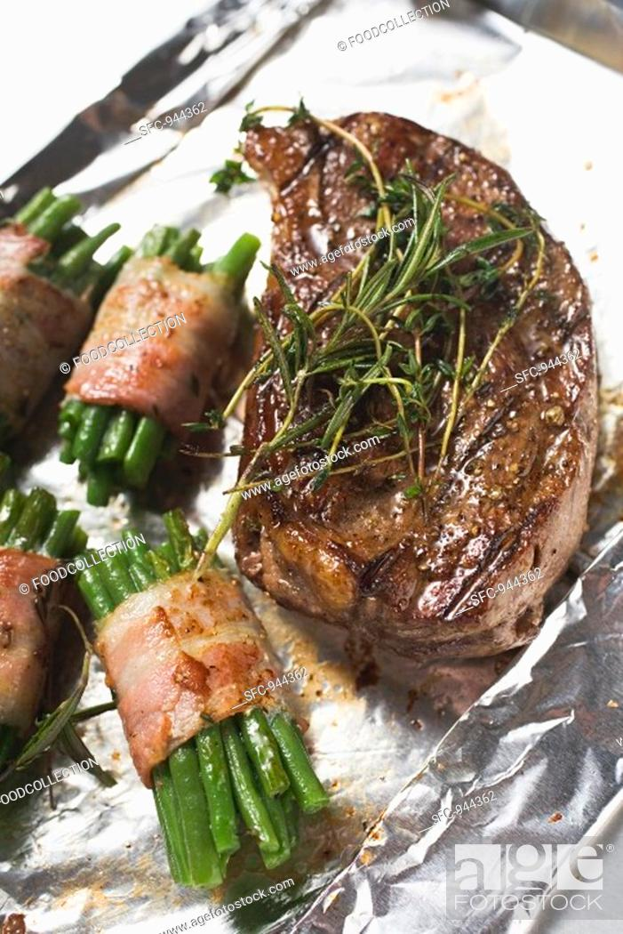 Stock Photo: Grilled beef steak with bacon-wrapped beans.