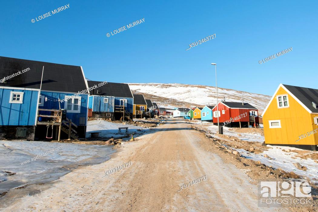 Stock Photo: Colourful wooden houses in the village of Qaanaaq, one of the most northerly human settlements on the planet and home to 656 mostly Inuit people.