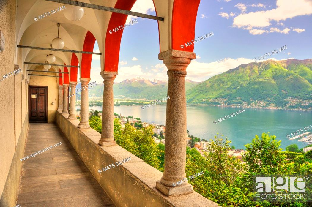 Stock Photo: Panoramic view over a lake and snow-capped mountain and arches.