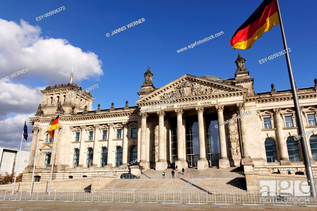Stock Photo: The Reichstag German Parlament building with German and EU flags streaming in the wind outside in Berlin, Germany.