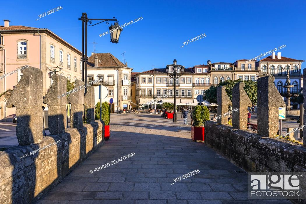 Stock Photo: View on Camoes Square from Roman bridge over Lima River in Ponte de Lima city, part of the district of Viana do Castelo, Norte region of Portugal.