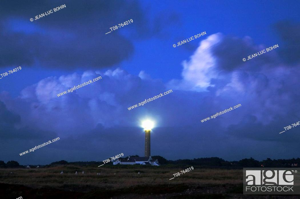 Stock Photo: Brittany, Belle-Ile: large lighthouse  under the cloudy sky.