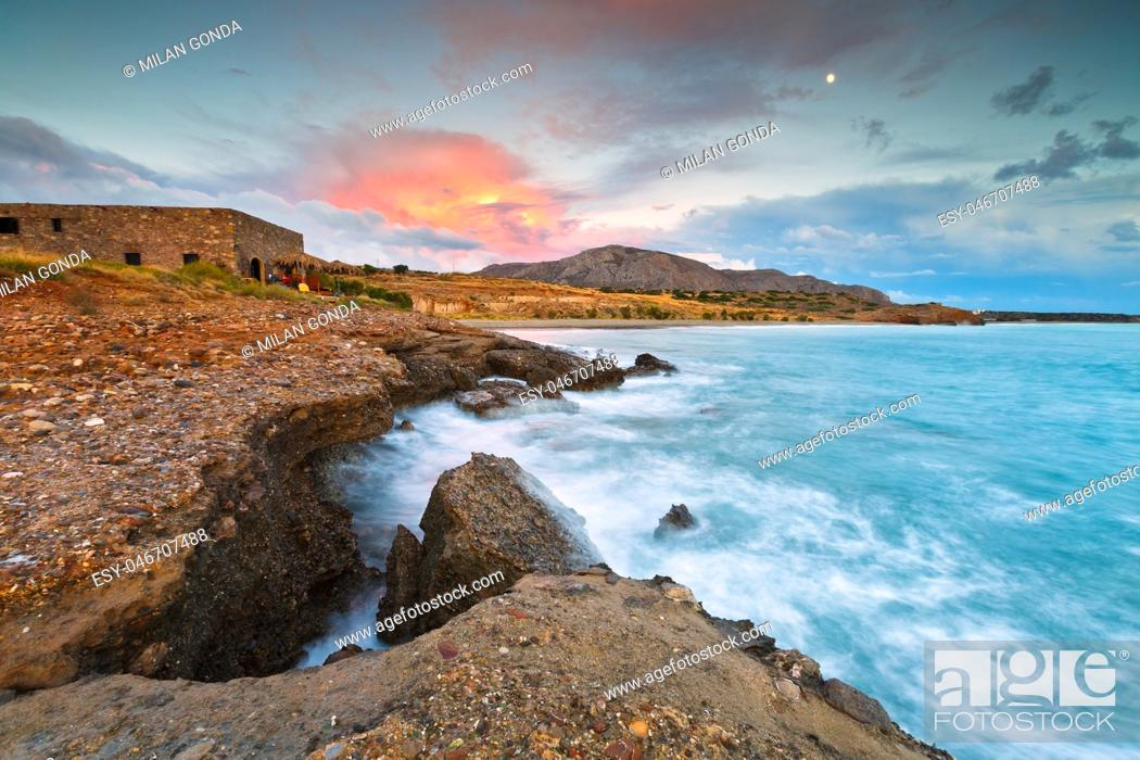 Stock Photo: Evening view of the Diaskari beach and old store houses near the village of Makrygialos in Crete, Greece. .