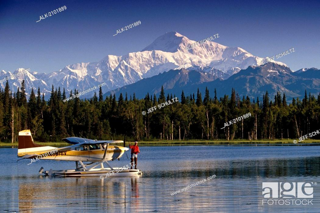 Photo de stock: Man Spin Fishing On Lake From Floatplane With Southside Mt. Mckinley And Alaska Range In The Background, Southcentral Alaska, Summer.
