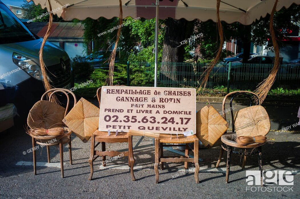 Stock Photo: A typical chair repairers stall in the Sunday market of the small village of Darnetal near Rouen in France.