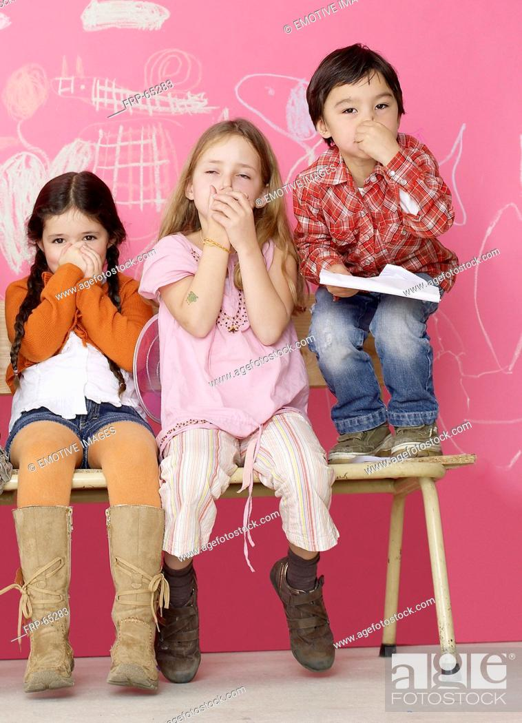 Stock Photo: Three children keeping their noses shut.