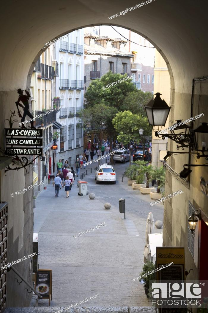 Stock Photo: Cuchilleros Arch and Cava de San Miguel Street from Plaza Mayor Square, Madrid, Spain.