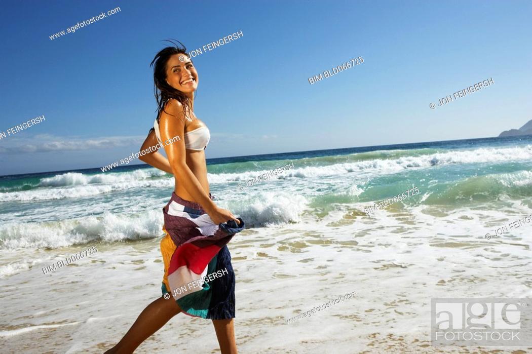 Stock Photo: Woman running at beach.