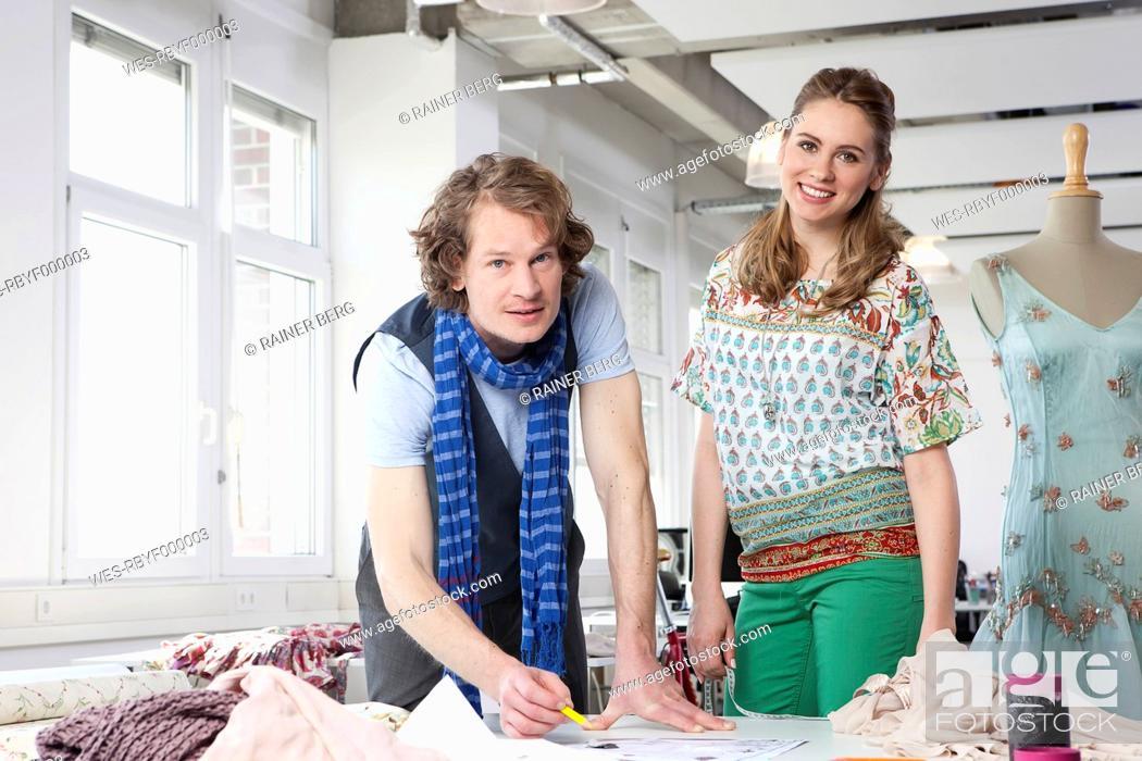 Stock Photo: Germany, Bavaria, Munich, Fashion designers working, smiling, portrait.