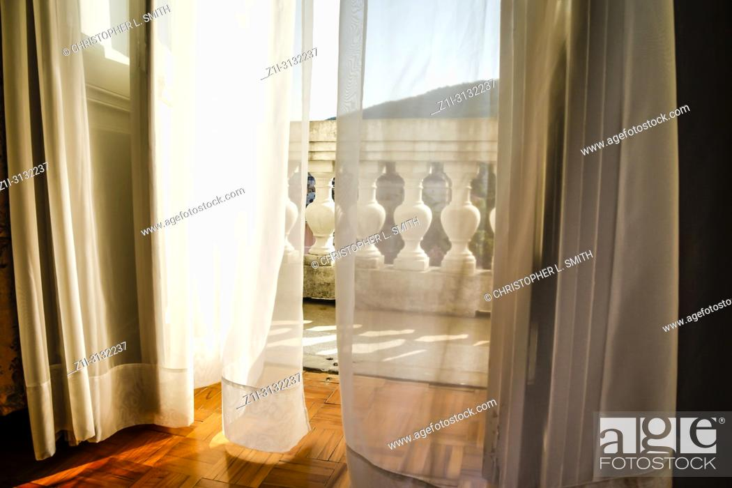Stock Photo: Behind net curtain drapes leads to the balcony at the Hotel Imperial in Opatija, Croatia.