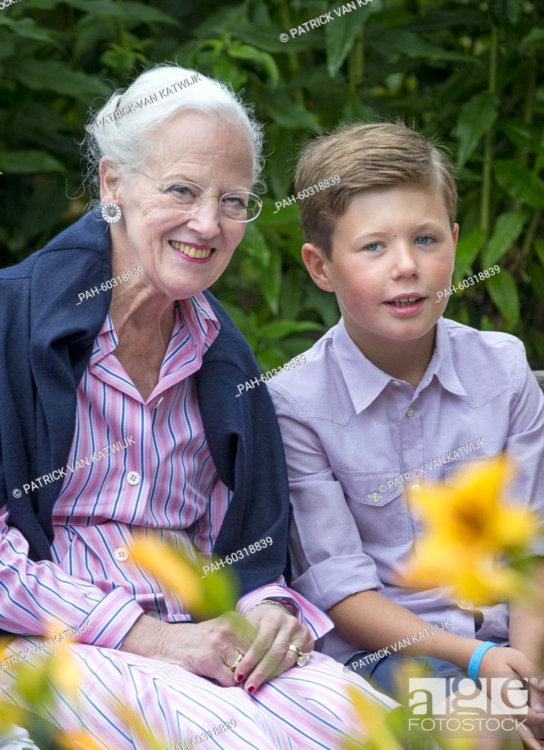 Stock Photo: Danish Queen Margarethe and Prince Christian during a photo session during their summer holidays at Grasten Slot, Denmark, 25 July 2015.