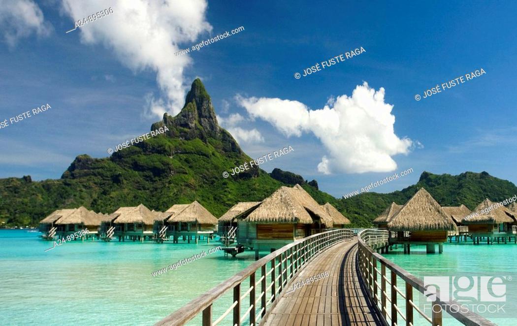 Stock Photo: Huts, lagoon and Mount Pahia, Bora Bora island, Society Islands, French Polynesia (May 2009).