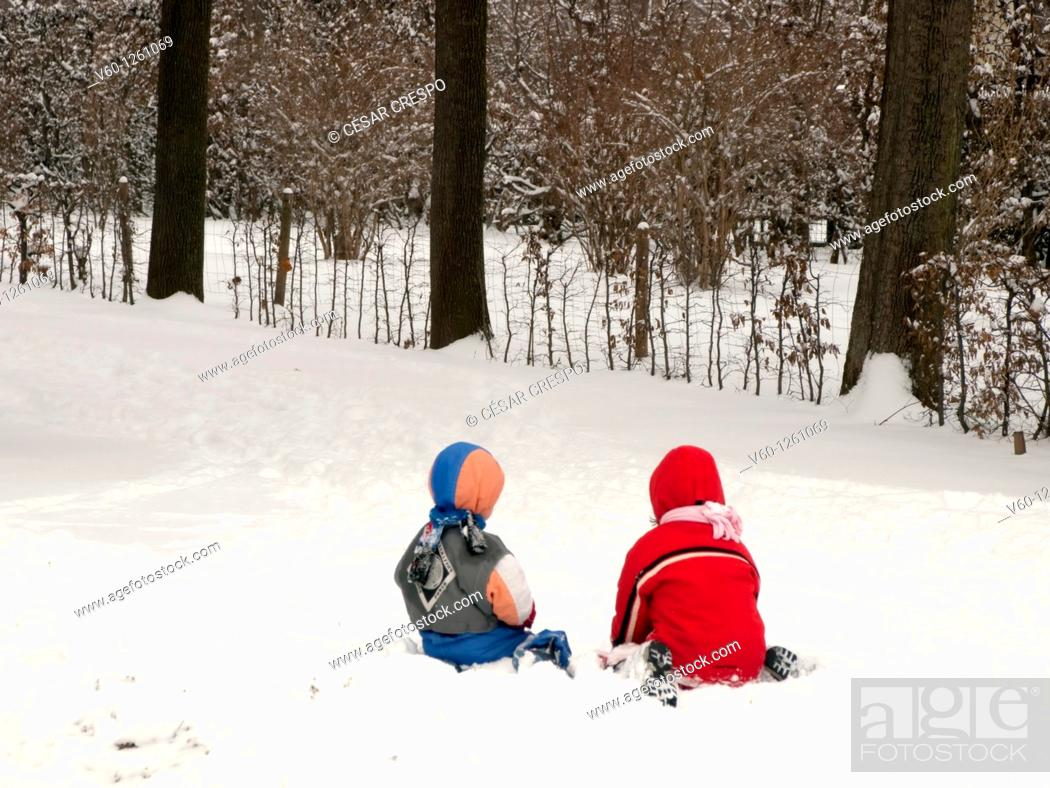 Stock Photo: -Kids playing with snow-.