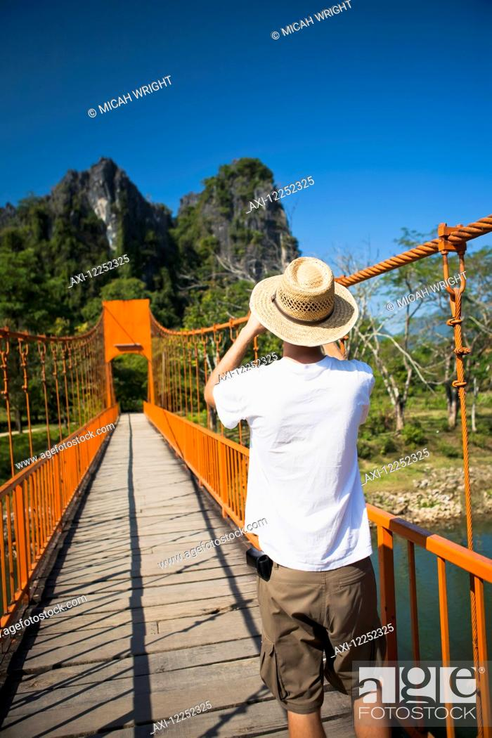 Stock Photo: A bridge leads to caves outside of Vang Vieng; Laos.