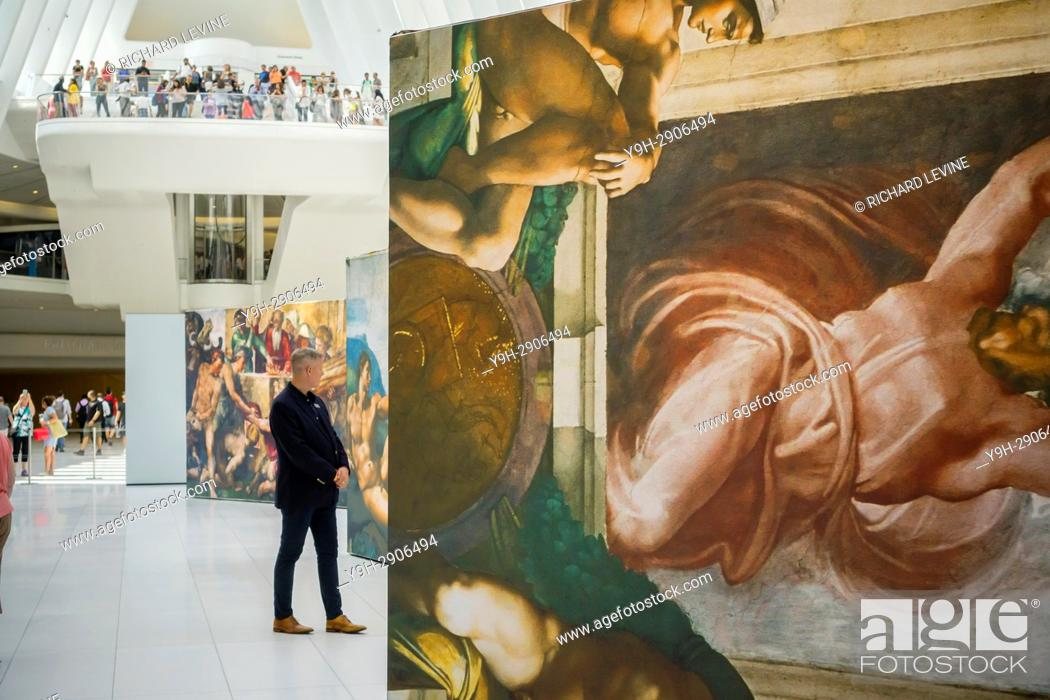 Stock Photo: Near life-size reproductions of Michelangelo's Sistine Chapel frescoes are seen on display in the Oculus in the World Trade Center Transportation Hub in New.