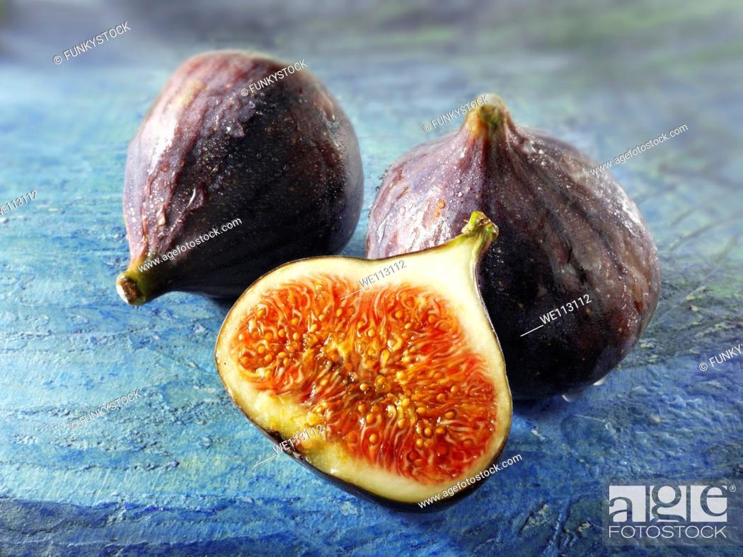 Stock Photo: Fresh whole & cut figs.
