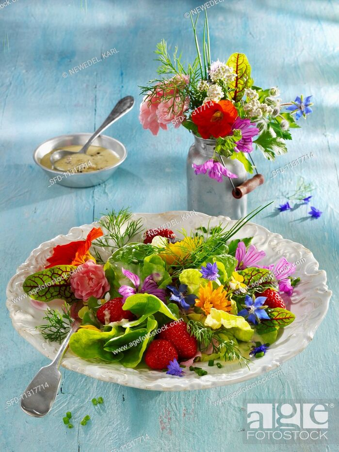 Stock Photo: An edible flower salad with strawberries.