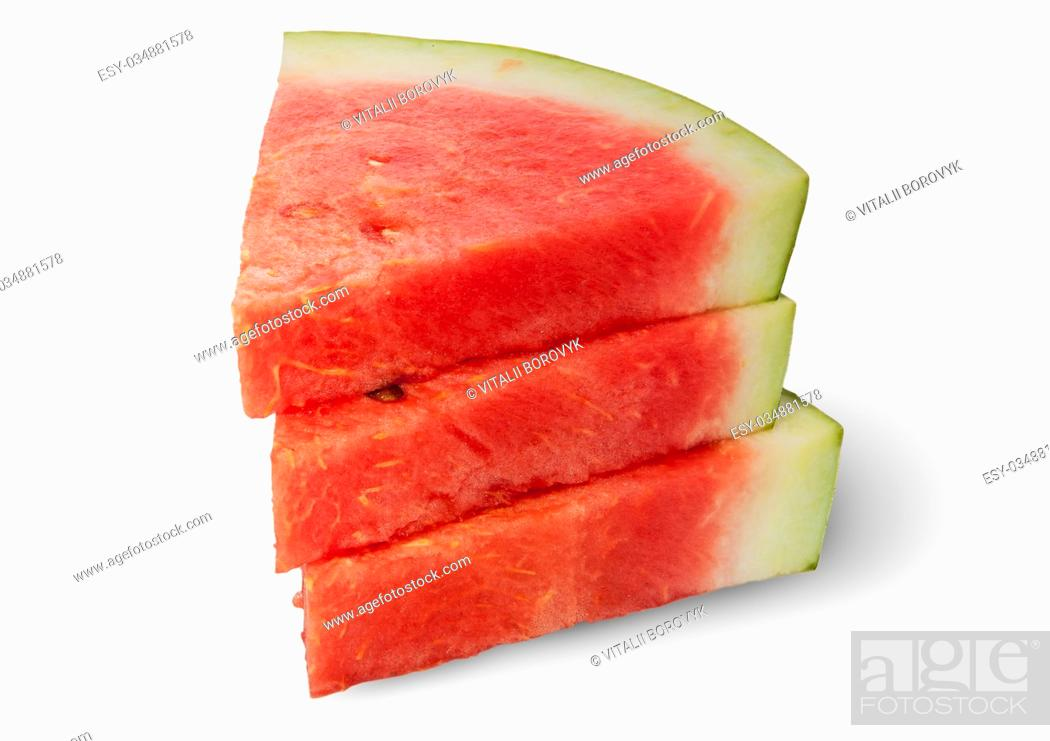 Imagen: Stack of three pieces of ripe red watermelon isolated on white background.