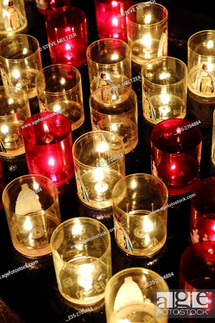 Stock Photo: Votive candles in a church les Saintes-Marie de la mer.