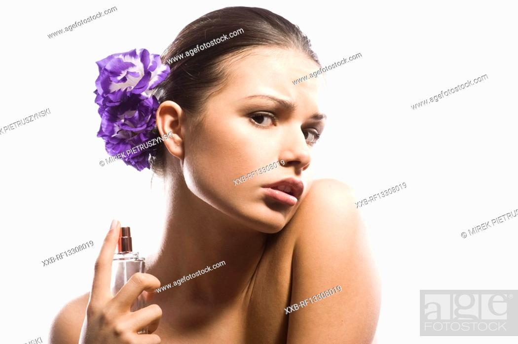 Stock Photo: woman perfuming neck.