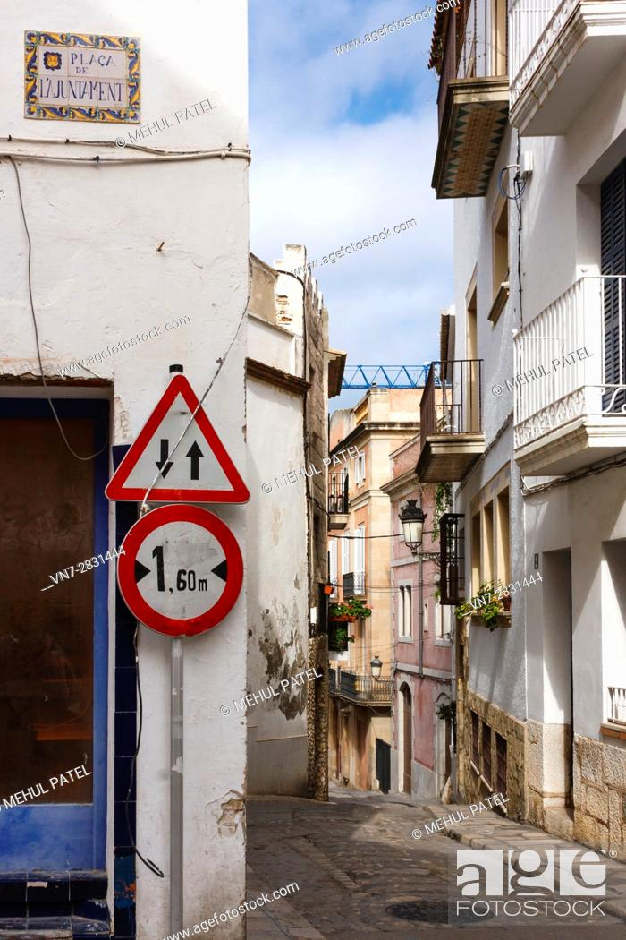 Imagen: Narrow street in the old town of Sitges by the town hall square, Catalonia, Spain, Europe.