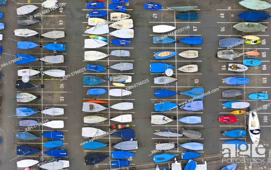 Stock Photo: Sailing boats stored in rows on dry land during coronavirus lockdown at North Berwick harbour in East Lothian. Scotland, UK.