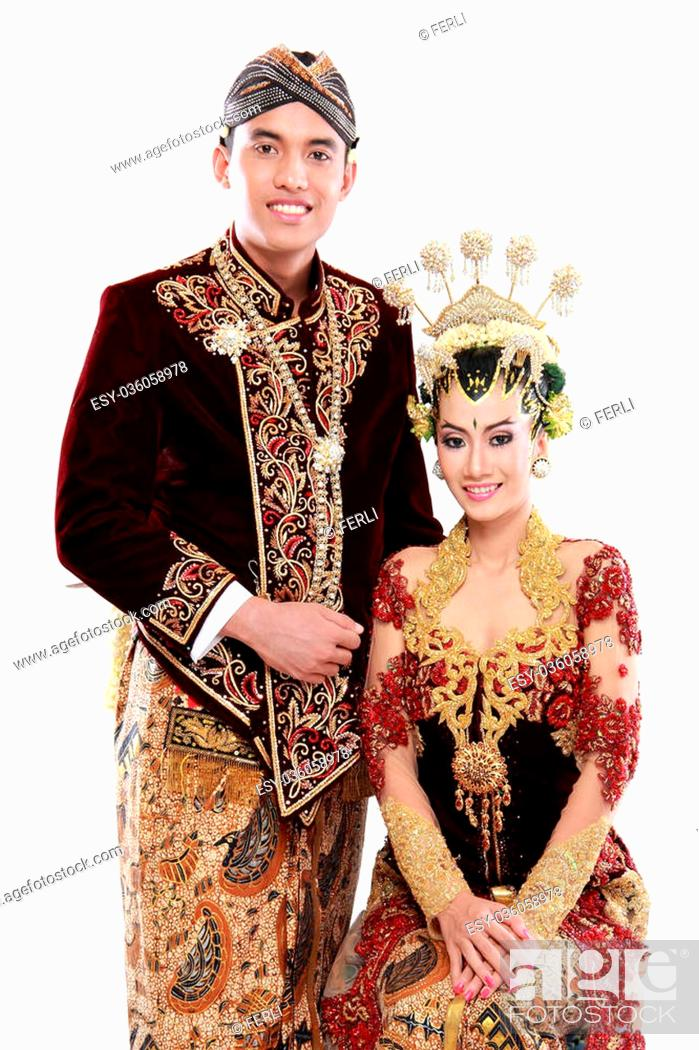 Photo de stock: traditional java wedding couple husband and wife hold each other isolated over white background.