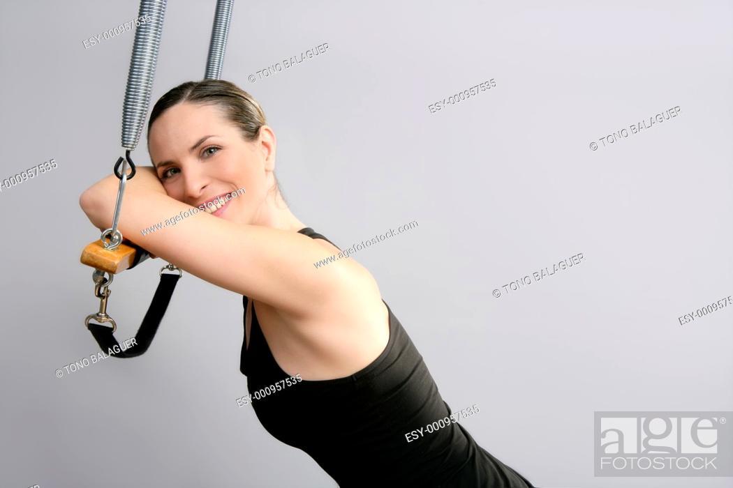 Stock Photo: Cadillac trapeze pilates woman portrait fitness sport beautiful girl.