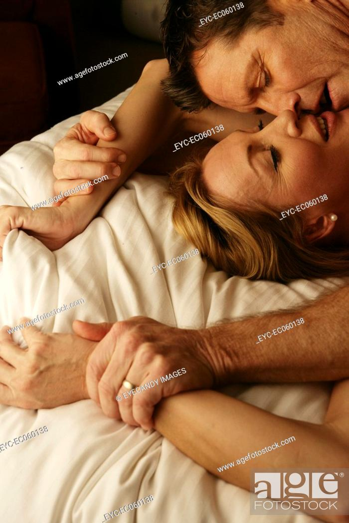 Stock Photo: Mature couple making love.