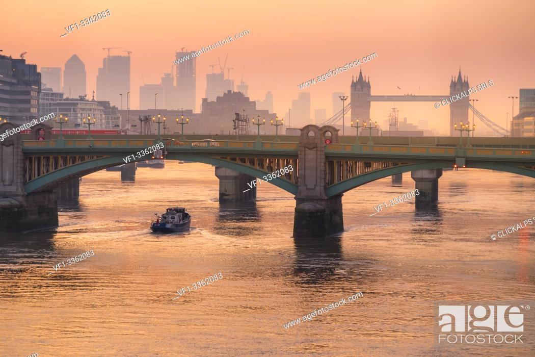 Stock Photo: Romantic sunrise over Southwark Bridge and London Bridge along River Thames, London, United Kingdom.