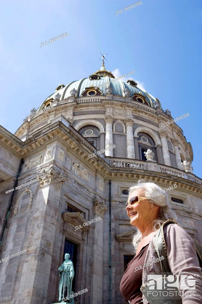 Stock Photo: Woman in front of church.