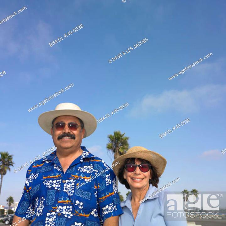 Stock Photo: Tourist couple smiling.