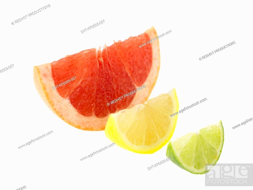 Stock Photo: Single slices of Lemon Lime and Blood Orange.