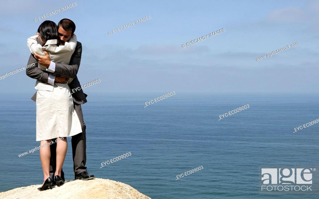 Stock Photo: View of a couple hugging each other on a cliff.