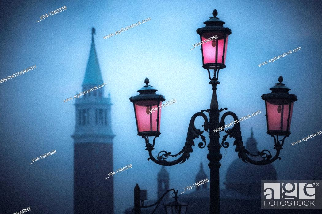 Stock Photo: Mystical view of a glowing lantern and the Campanile in Venice, Italy, Europe.