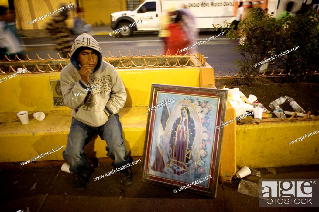 Stock Photo: A pilgrim sits by an image of Our Lady of Guadalupe virgin in Mexico City, December 11, 2010  Hundreds of thousands of Mexican pilgrims converged on the Our.