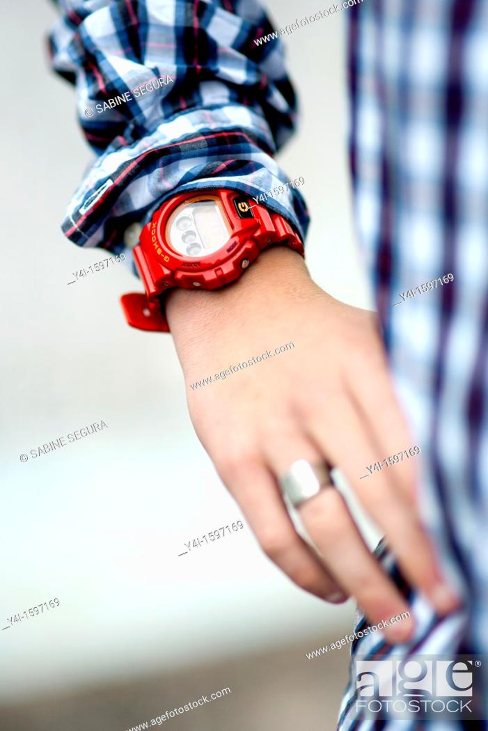 Stock Photo: Detail of a teenager wearing a G-shock watch.