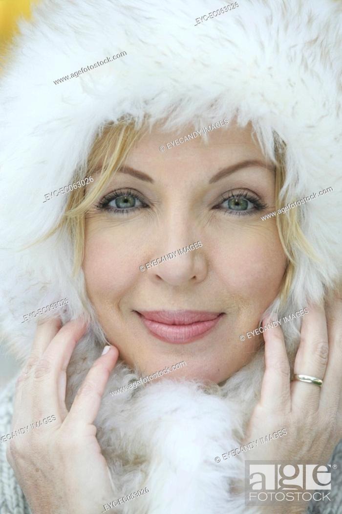 Stock Photo: Close-up of blond woman wearing a fur hat.
